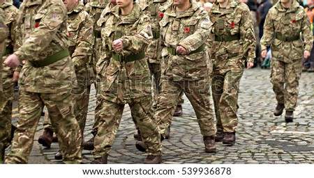 Members of the British Armed forces in uniform marching