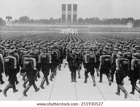 stock-photo-members-of-the-ss-marching-in-formation-on-nazi-party-day-nuremberg-germany-september-251930527.jpg
