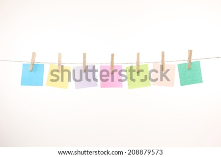 memo notes of different colors on a string