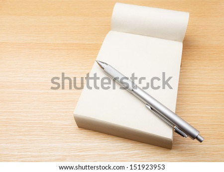 Memo pad and pen on the table