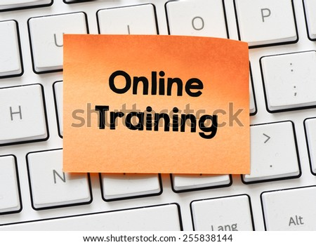 Memo with online training. Memo with online training on white keyboard - stock photo
