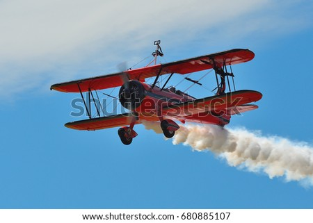 Memorial Airshow, 24th of June 2017, Roudnice, Czech Republic. Bucker Jungmeister in flight, smoke effect