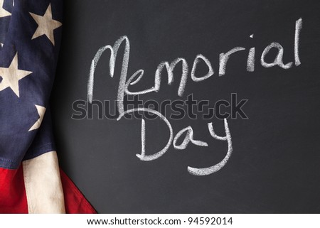 Memorial Day holiday sign written on a chalkboard with vintage American flag - stock photo