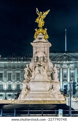 Memorial to Queen Victoria (1911) at night in front of Buckingham Palace was built in honor of Queen Victoria, who reigned for almost 64 years. Memorial was designed by Sir Aston Webb. London, UK - stock photo