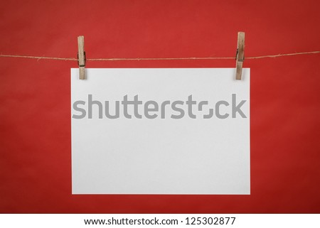 Memory note white paper hanging on cord on red background