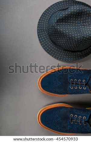 Men accessory, outfit. Black fedora hat, suede shoes on the grey background. Top view, copy space, frame. Wedding.