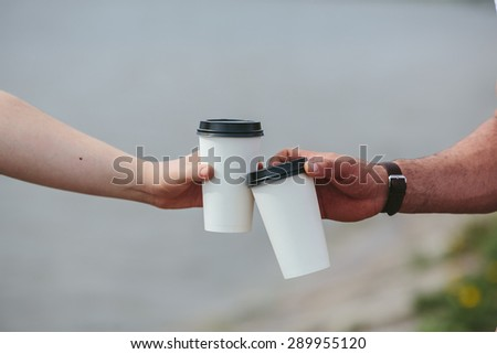 Men and coffee on the beach