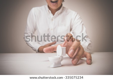 Men and toilet - stock photo