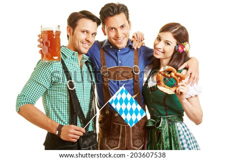Men and woman with beer and pretzel at Oktoberfest in Bavaria - stock photo