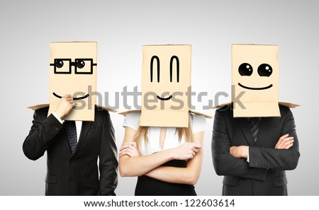 men and woman with smiling box on head - stock photo