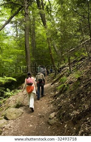 Men and Women Hikers on a Trail in Forest