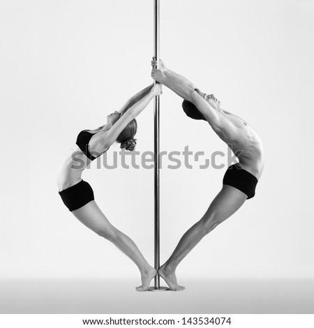 Men and women on pylon - stock photo