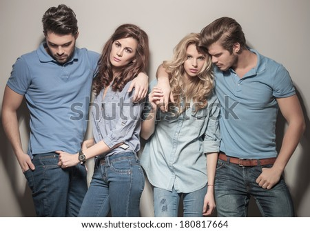 men and women standing together in casual jeans clothes , posing for the camera - stock photo