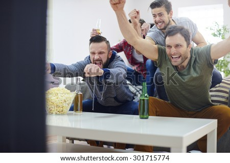 Men are proud of their team that won the game - stock photo