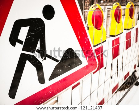 men at work sign at a road construction site in vienna