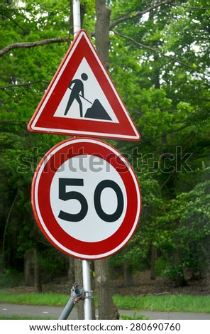 Men at work sign in the countryside in north Belgium - stock photo