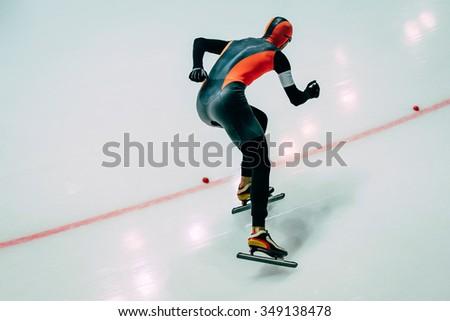 men athlete to sprint speed skating.  speed skating  indoors - stock photo