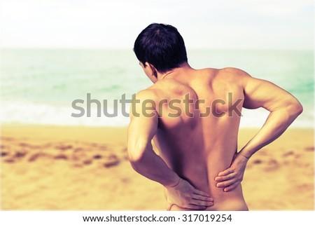 Men Backache. - stock photo