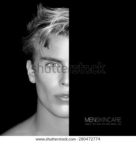 Men beauty skin care concept. Handsome young man half face. Perfect skin. Monochrome Portrait isolated on black. Template design with sample text - stock photo