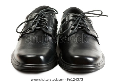 Men black shoes with black laces over white background