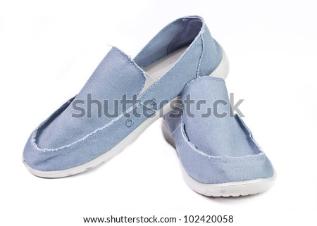 Men blue canvas shoes isolated on white background - stock photo