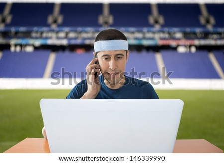 men bringing in competitions and calling to make your bet from a stadium - stock photo