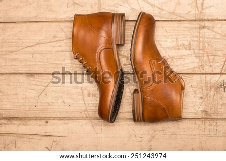 Men Brown Shoes on wooden background