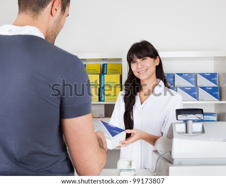 Men buying some medicine at the drugstore