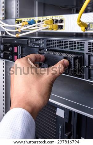 Men change computer hard disk drive - stock photo