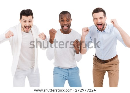Men cheering. Three happy young men in smart casual wear expressing positivity and gesturing while standing against white background