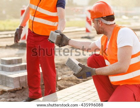 Men construction workers working in a team - stock photo