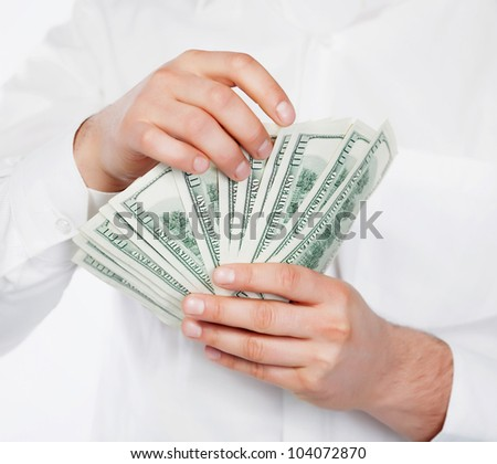 Men counting dollars in hands - stock photo