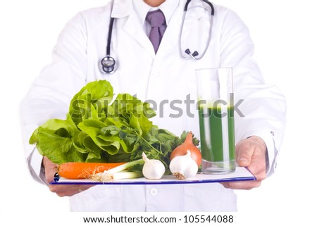 men doctor holding fresh vegetables - stock photo