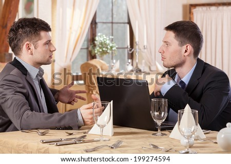 Men during business meeting in a restaurant - stock photo