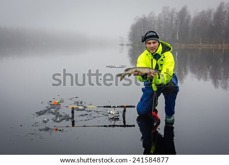 Men fishing pikes on ice