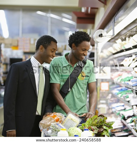Men Grocery Shopping Together - stock photo