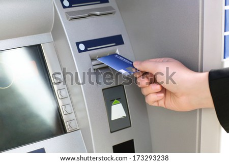 men hand businessman puts credit card into ATM - stock photo