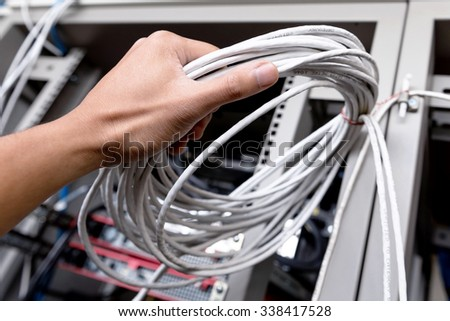 men hand hold UTP Computer Network Cable
