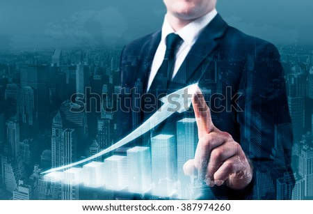 men hand is drawing a up graph. - stock photo