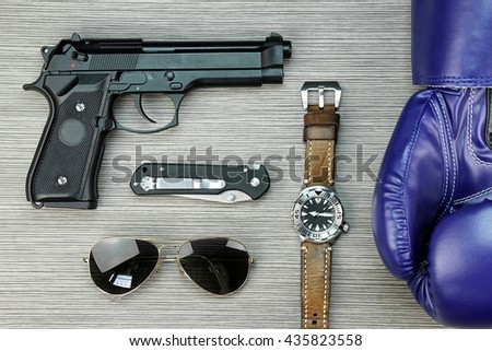 Men hobbies and collectibles, Men hobbies and interests, Boxing gloves, Watch, Gun, Sunglasses, Combat Knife. - stock photo
