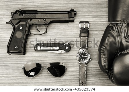 Men hobbies and collectibles, Men hobbies and interests, Boxing gloves, Watch, Gun, Sunglasses, Combat Knife. (?Black & White) - stock photo