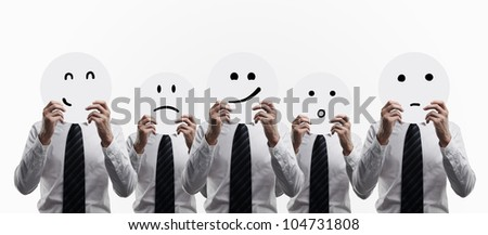 men hold plates with smilies on white background - stock photo