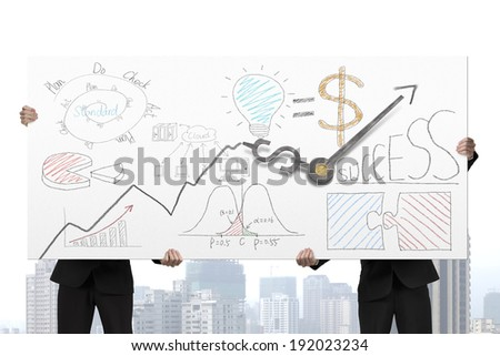 Men holding board with clock hands and business doodles on it - stock photo