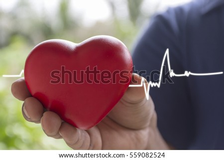 Men holding heart with beat line end of life as a symbol of love ,valentines day background. / lighting effect vintage style