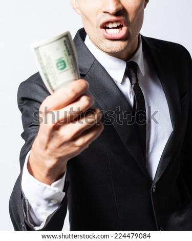 Men holding money - stock photo