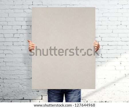 men holding white blank poster