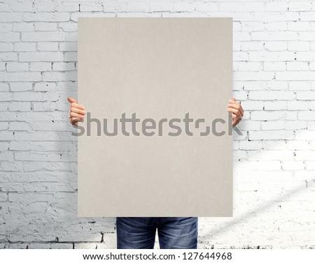 men holding white blank poster - stock photo