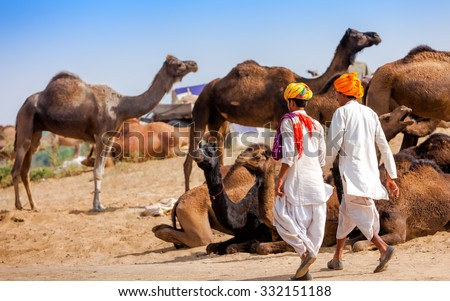 Men in ethnic attire attends the Pushkar fair in Rajasthan, India. Farmers and traders from all over Rajasthan flock for the annual fair. - stock photo