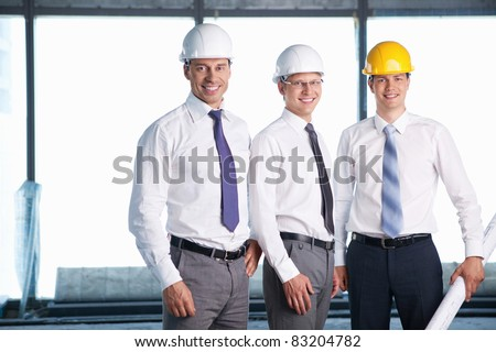 Men in helmets on a construction site