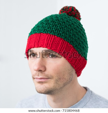 Men in knitted Elf red-green hat